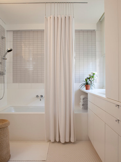 inspiration for a gray tile tubshower combo remodel in new york with an