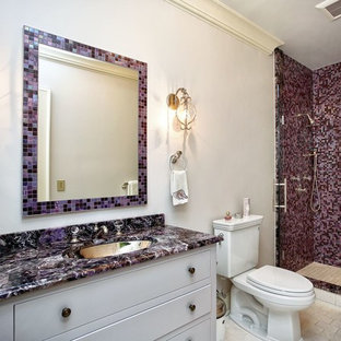 Example of a transitional 3/4 multicolored tile beige floor alcove shower design in New York with flat-panel cabinets, white cabinets, a two-piece toilet, beige walls, an undermount sink, a hinged shower door and purple countertops