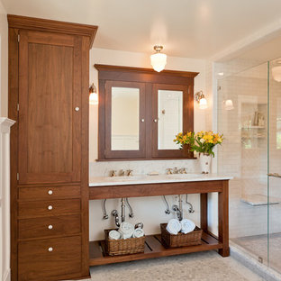 Inspiration for a mid-sized contemporary 3/4 white tile and subway tile pebble tile floor and white floor bathroom remodel in San Francisco with an undermount sink, open cabinets, medium tone wood cabinets, white walls, a two-piece toilet, marble countertops, a hinged shower door and white countertops