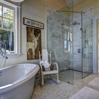 Mountain style master mosaic tile and gray tile bathroom photo in Toronto with beige walls