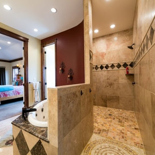 Inspiration for a large craftsman master beige tile and ceramic tile ceramic floor doorless shower remodel in Salt Lake City with raised-panel cabinets, medium tone wood cabinets, granite countertops and beige walls