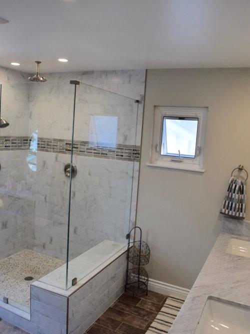 Foto e Idee per Bagni - bagno con pavimento in laminato e piastrelle a listelli