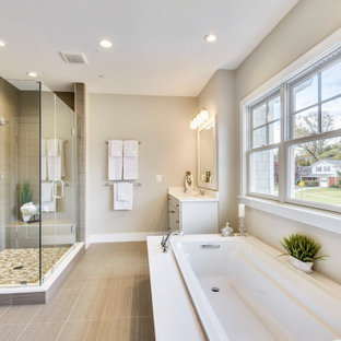 Large transitional 3/4 porcelain floor, beige floor and single-sink bathroom photo in DC Metro with shaker cabinets, white cabinets, beige walls, an undermount sink, a hinged shower door, beige countertops, a niche and a built-in vanity