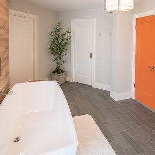 Example of a large minimalist master brown tile and porcelain tile slate floor and gray floor bathroom design in Detroit with flat-panel cabinets, white cabinets, gray walls, an undermount sink, quartzite countertops and a hinged shower door
