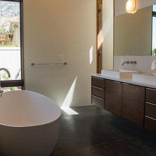 Inspiration for a mid-sized modern master white tile and ceramic tile concrete floor bathroom remodel in Salt Lake City with flat-panel cabinets, dark wood cabinets, quartz countertops, a two-piece toilet and white walls