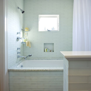 Example of a mid-sized classic master blue tile and glass tile tub/shower combo design in San Francisco with an undermount tub, recessed-panel cabinets, white cabinets, an undermount sink and engineered quartz countertops