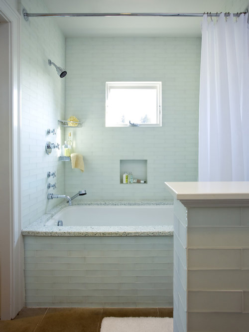 Example of a mid-sized classic master blue tile and glass tile tub/shower