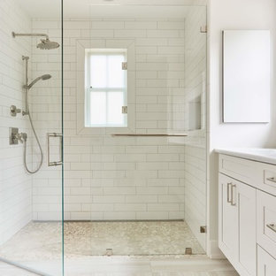 Inspiration for a large country master white tile and mosaic tile light wood floor and beige floor alcove shower remodel in Richmond with shaker cabinets, white cabinets, a two-piece toilet, white walls, an undermount sink, quartzite countertops, a hinged shower door and white countertops