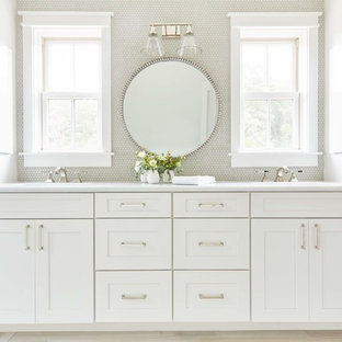 Example of a large cottage master white tile and mosaic tile light wood floor and beige floor alcove shower design in Richmond with shaker cabinets, white cabinets, white walls, white countertops, a two-piece toilet, an undermount sink, quartzite countertops and a hinged shower door