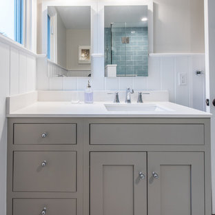 Inspiration for a medium sized contemporary family bathroom in DC Metro with recessed-panel cabinets, green cabinets, beige walls, mosaic tile flooring, a submerged sink, engineered stone worktops and white floors.