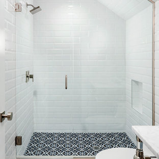 Minimalist white tile and subway tile cement tile floor alcove shower photo in Orlando with white walls, a pedestal sink and a hinged shower door