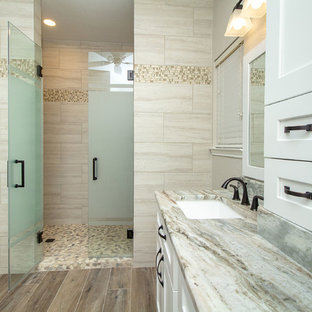 Mid-sized elegant master beige tile and porcelain tile porcelain tile and brown floor alcove shower photo in Houston with shaker cabinets, white cabinets, beige walls, an undermount sink, granite countertops, a hinged shower door and gray countertops