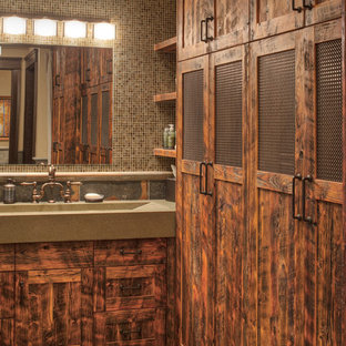 Example of a large mountain style master brown tile and mosaic tile slate floor and multicolored floor alcove shower design in Other with a trough sink, concrete countertops, shaker cabinets, medium tone wood cabinets, multicolored walls and a hinged shower door