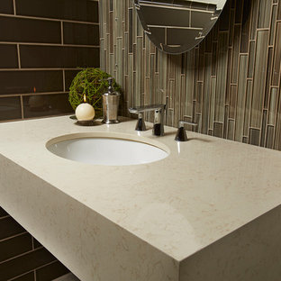 Trendy master white tile and porcelain tile doorless shower photo in Phoenix with an undermount sink, quartz countertops, medium tone wood cabinets and beige walls