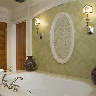 Inspiration for a mediterranean bathroom in Los Angeles with a submerged bath, green tiles and mosaic tiles.
