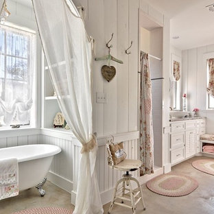 Inspiration for a shabby-chic style concrete floor bathroom remodel in Austin with a vessel sink, white cabinets and white walls