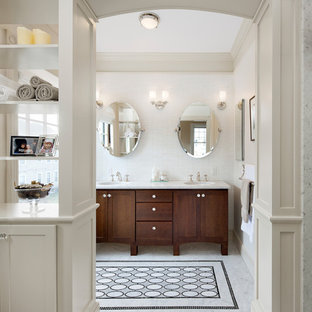 Inspiration for a victorian bathroom in Boston with an undermount sink, dark wood cabinets, white tile and shaker cabinets.