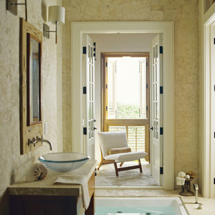 Inspiration for a mid-sized tropical master bathroom in Miami with medium wood cabinets, a hot tub, beige walls, a vessel sink, open cabinets and ceramic floors.