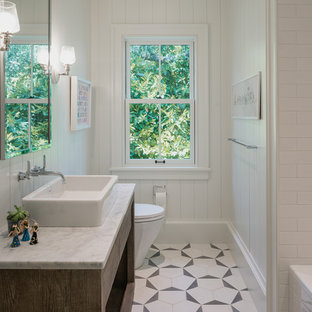 Example of a mid-sized trendy 3/4 white tile and subway tile white floor and mosaic tile floor bathroom design in San Francisco with flat-panel cabinets, white walls, a vessel sink, white countertops, dark wood cabinets, a one-piece toilet and marble countertops