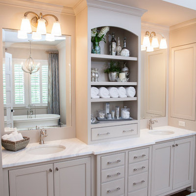 Farmhouse bathroom photo in Atlanta with an undermount sink, recessed-panel cabinets and gray cabinets