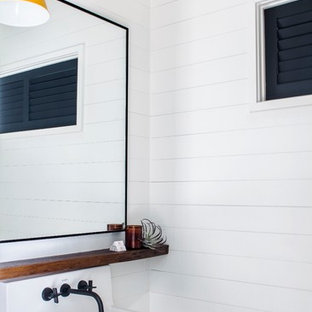 Beach style bathroom photo in Atlanta with white walls and a wall-mount sink