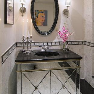 Immagine di una stanza da bagno minimal con consolle stile comò e piastrelle bianche