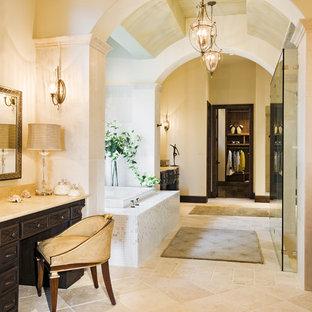 Design ideas for a mediterranean bathroom in Austin with a built-in bath.