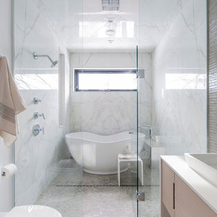 Inspiration for a contemporary bathroom in Toronto with a freestanding tub and mosaic tile.