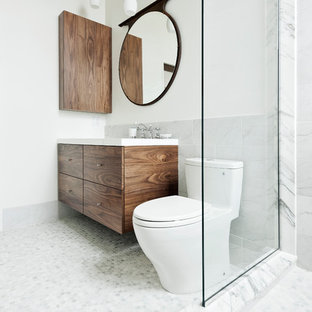 Bathroom - mid-sized contemporary white tile, gray tile and stone tile mosaic tile floor and gray floor bathroom idea in Montreal with flat-panel cabinets, dark wood cabinets, white walls, a two-piece toilet and an integrated sink