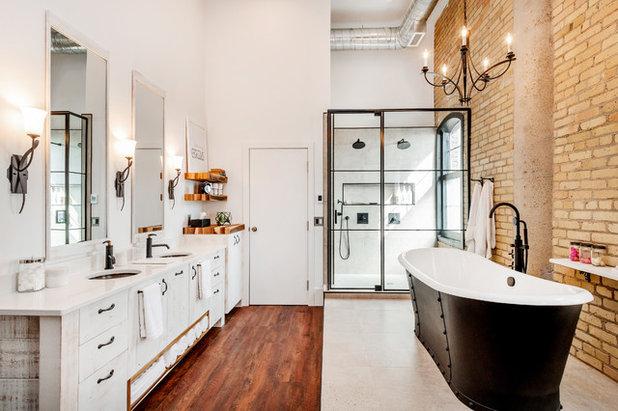 Industrial Bathroom by Haven Builders Inc