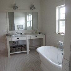 Farmhouse Bathroom by Artisan Craft Homes