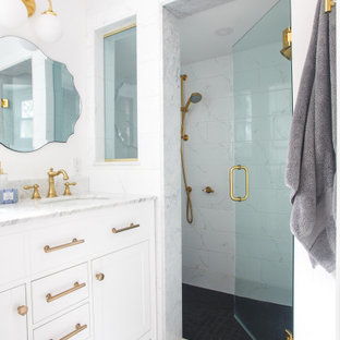 Bathroom - small transitional white tile and marble tile marble floor, multicolored floor and double-sink bathroom idea in Boston with shaker cabinets, white cabinets, a two-piece toilet, white walls, an undermount sink, marble countertops, a hinged shower door, white countertops and a built-in vanity