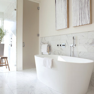 Example of a minimalist subway tile freestanding bathtub design in San Francisco