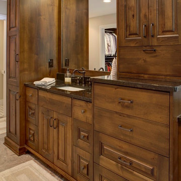 Rustic Alder cabinetry with painted and glazed island.