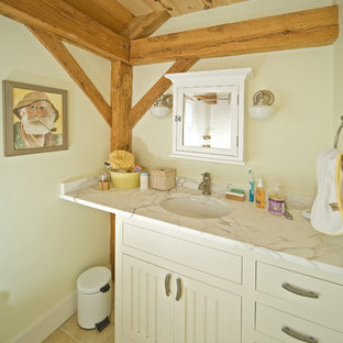 Example of a mountain style bathroom design in Boston with marble countertops and an undermount sink
