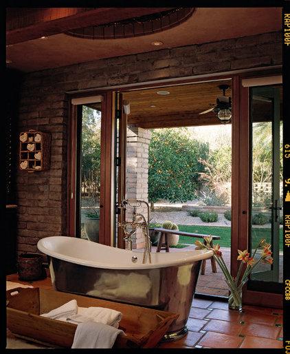 Rustic Bathroom by Carson Poetzl, Inc.