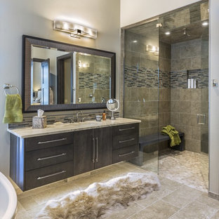 Inspiration for a rustic master beige tile, multicolored tile and matchstick tile beige floor alcove shower remodel in Philadelphia with flat-panel cabinets, dark wood cabinets, beige walls, an undermount sink, a hinged shower door and beige countertops