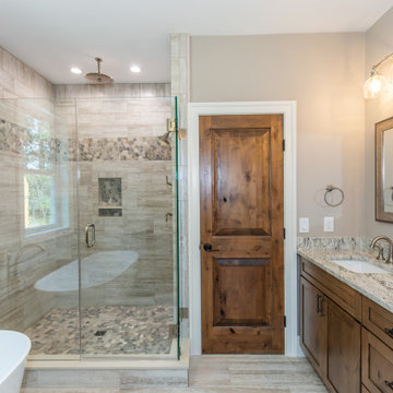 Rustic Bathroom featuring Knotty Alder cabinets and doors