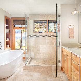 Freestanding bathtub - rustic master beige tile and multicolored tile beige floor freestanding bathtub idea in Other with shaker cabinets, light wood cabinets, beige walls, an undermount sink, a hinged shower door and beige countertops