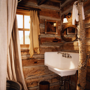 Example Of A Mountain Style Bathroom Design In Other With A Wall Mount Sink