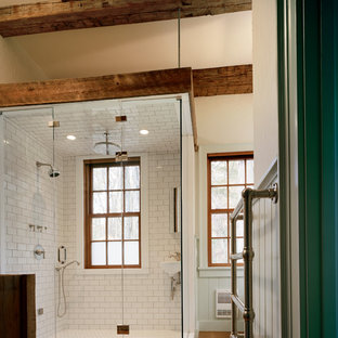 Example of a mountain style white tile and subway tile alcove shower design in New York