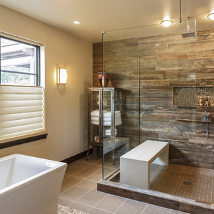 Example of a mountain style master brown tile gray floor bathroom design in Los Angeles with white walls and a hinged shower door