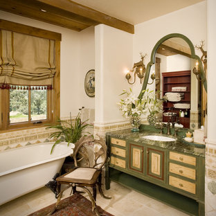 Photo of a rustic bathroom in Tampa with freestanding cabinets, green cabinets, a claw-foot bath, white walls, a submerged sink, beige floors and green worktops.
