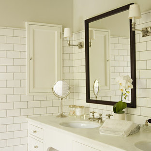 Elegant white tile and subway tile bathroom photo in Los Angeles with an undermount sink and white cabinets