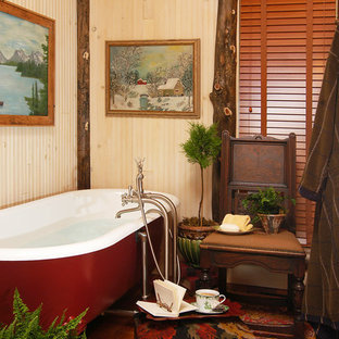 Example of a large mountain style master medium tone wood floor claw-foot bathtub design in Charlotte with beige walls