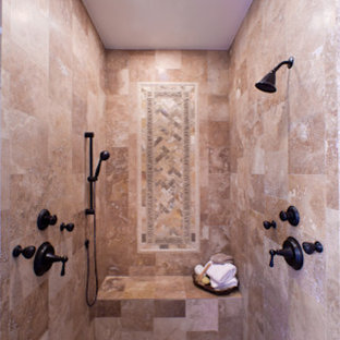 Inspiration for a large rustic master beige tile and stone tile travertine floor bathroom remodel in Houston with an undermount sink, raised-panel cabinets, medium tone wood cabinets, granite countertops, a one-piece toilet and beige walls