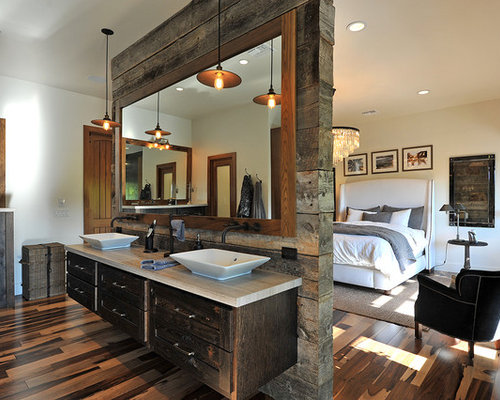 bathroom idea in Los Angeles with a vessel sink, dark wood cabinets