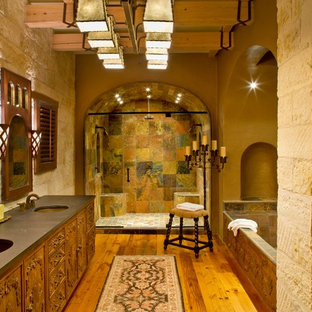 Example of a southwest slate tile bathroom design in Houston with an undermount sink