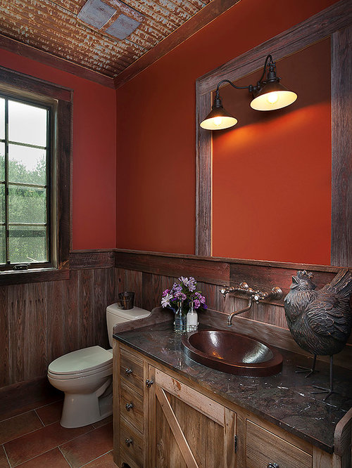Stanza da bagno con piastrelle in pietra e pareti arancioni foto idee arredamento - Bagno piastrelle marroni ...