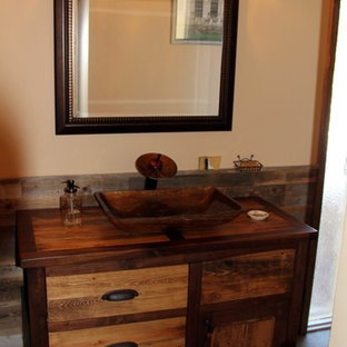 Photo of a mid-sized country bathroom in DC Metro with recessed-panel cabinets, distressed cabinets, gray tile, stone tile, orange walls, slate floors and wood benchtops.